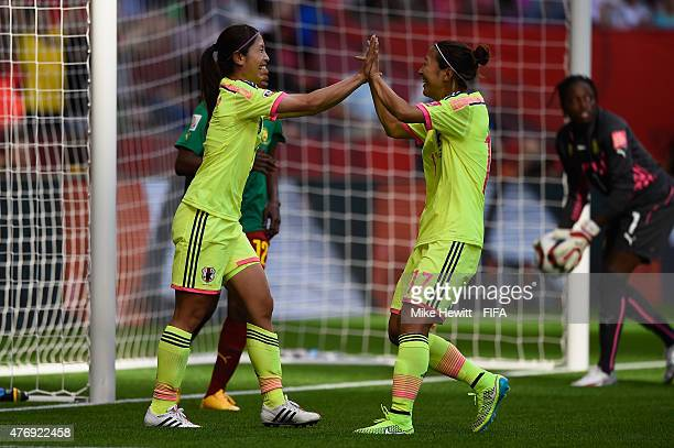 Aya Sameshima of Japan celebrates with team mate Yuki Ogimi after opening the scoring during the FIFA Women's World Cup 2015 Group C match between...