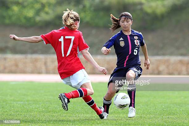 Aya Sameshima of Japan challenges Ingrid Ryland of Norway action during the Algarve Cup match between Japan and Norway at the Complexo Desportivo...