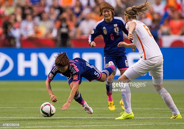 Aya Sameshima of Japan falls to the ground after battling for the ball with Anouk Dekker of the Netherlands during the FIFA Women's World Cup Canada...