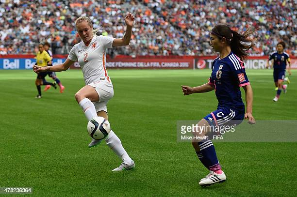 Aya Sameshima of Japan is challenged by Desiree van Lunteren of Netherlands during the FIFA Women's World Cup 2015 Round of 16 match between Japan...