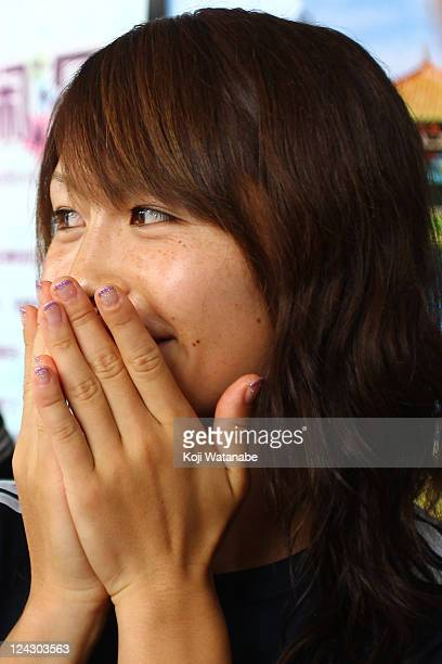 Aya Sameshima of Japan reacts during a press conference after securing a berth for the London 2012 Olympics at a convention center on September 9...