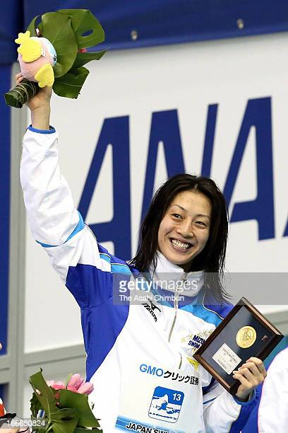 Aya Terakawa celebrates on the podium winning the Women's 100m Backstroke final during day two of the Japan Swim 2013 at Daiei Probis Phoenix Pool on...