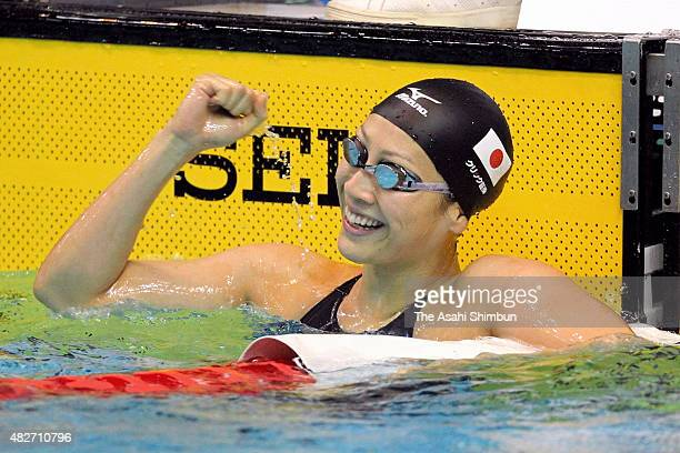 Aya Terakawa of Japan celebrates winning the Women's 100m Backstroke final during day two of the FINA World Cup Tokyo at Tokyo Tatsumi international...