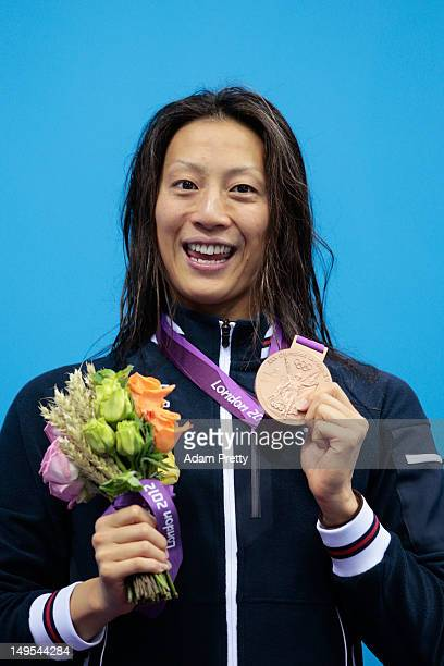 Aya Terakawa of Japan celebrates with her bronze medal during the medal ceremony for the Women's 100m Backstroke on Day 3 of the London 2012 Olympic...