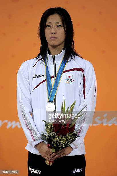 Aya Terakawa of Japan poses with the medal won in the Women's 50m Backstroke final at Aoti Aquatics Centre during day three of the 16th Asian Games...