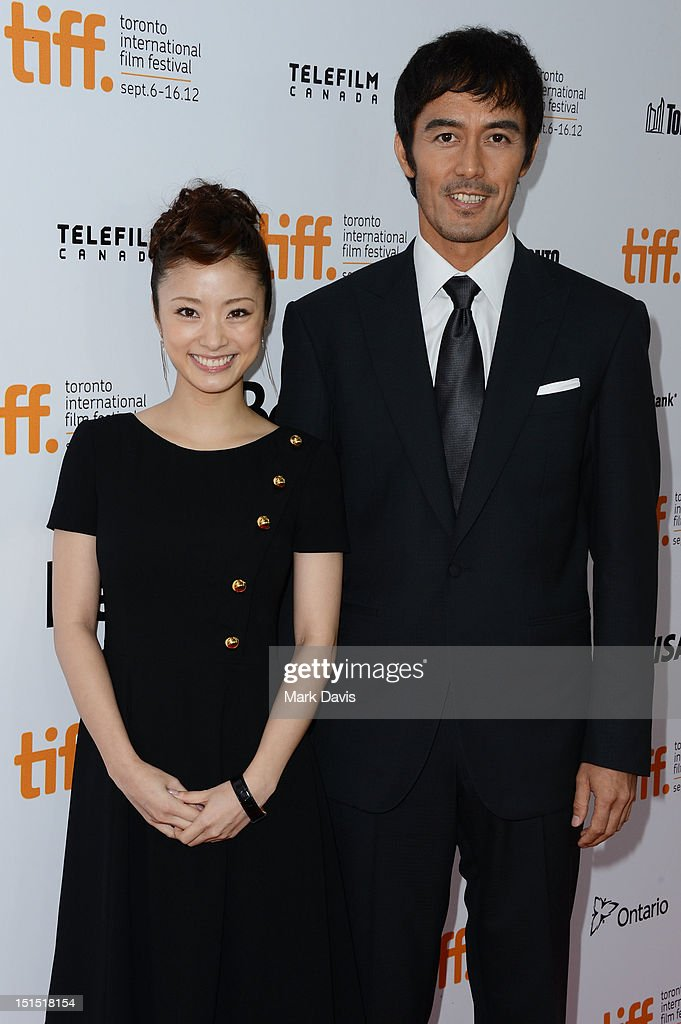 <a gi-track='captionPersonalityLinkClicked' href=/galleries/search?phrase=Aya+Ueto&family=editorial&specificpeople=2116424 ng-click='$event.stopPropagation()'>Aya Ueto</a> (L) and Hiroshi Abe attend the 'Thermae Romae' premiere during the 2012 Toronto International Film Festival at Roy Thomson Hall on September 8, 2012 in Toronto, Canada.
