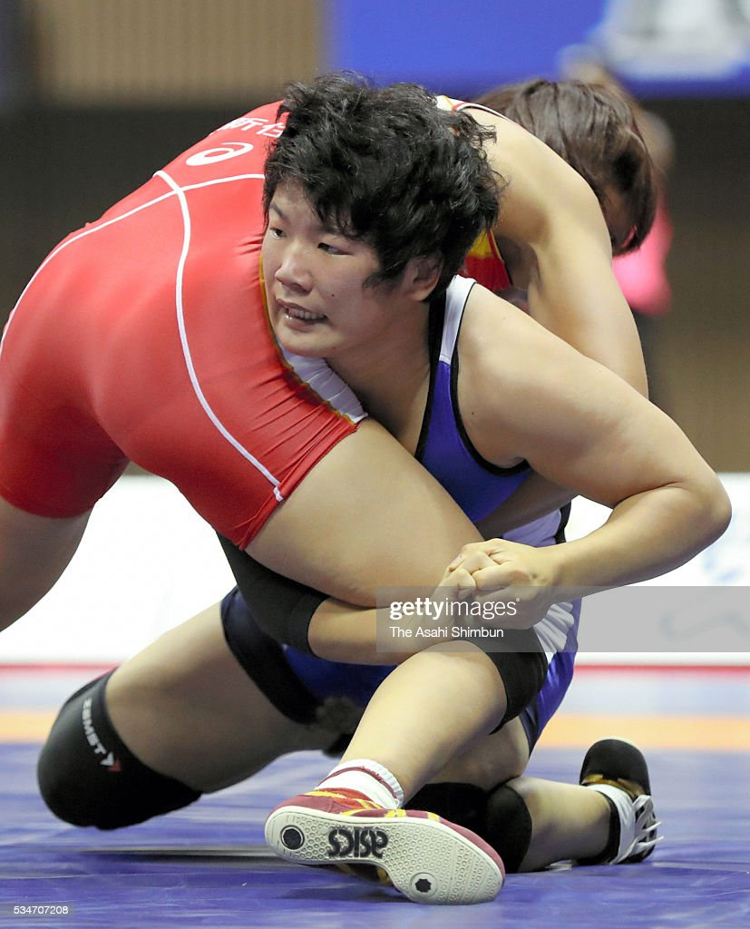 Ayaka Ito (red) and Yui Sakano (blue) compete in the Women's -60kg final during day one of the All Japan Wrestling Invitational Championships at the Yoyogi National Gymnasium on May 27, 2016 in Tokyo, Japan.
