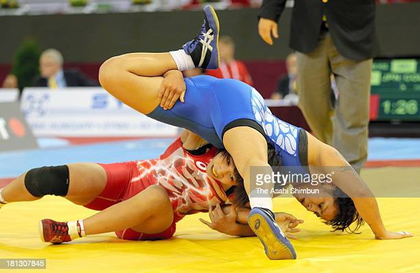 Ayaka Ito of Japan and Ayaulym Kassymova of Kazakhstan compete in the Women's 59kg first round during day four of the FILA Wrestling World...
