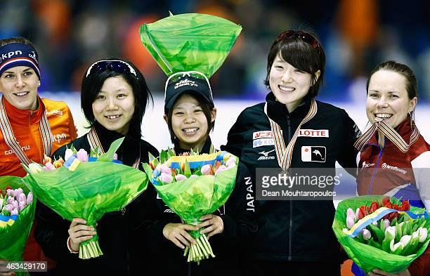 Ayaka Kikuchi Miho Takagi and Nana Takagi celebrate winning the gold medal and becoming the new world champions with silver medallists the...
