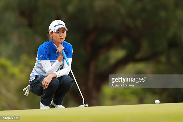 Ayaka Matsumori of Japan lines up her birdie putt on the 4th green during the final round of the Daikin Orchid Ladies Golf Tournament at the Ryukyu...
