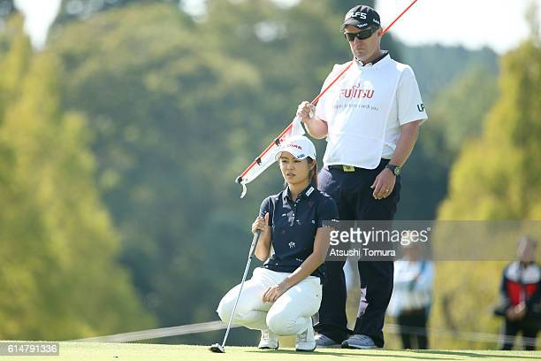Ayaka Matsumori of Japan lines up her putt on the 18th green during the second round of the Fujitsu Ladies 2016 at the Tokyu Seven Hundred Club on...