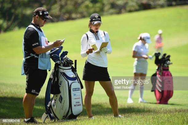 Ayaka Matsumori of Japan looks at her yardage book on the 6th hole during the second round of the HokennoMadoguchi Ladies at the Fukuoka Country Club...