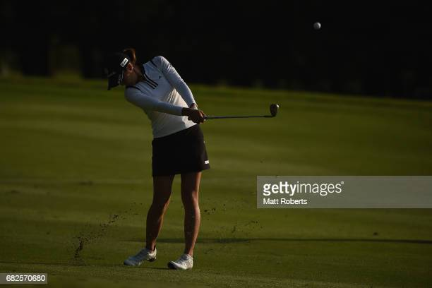 Ayaka Matsumori of Japan plays her approach shot on the 18th hole during the second round of the HokennoMadoguchi Ladies at the Fukuoka Country Club...