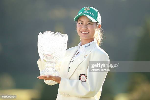 Ayaka Matsumori of Japan poses with the trophy after winning the Fujitsu Ladies 2016 at the Tokyu Seven Hundred Club on October 16 2016 in Chiba Japan