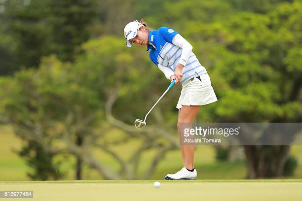 Ayaka Matsumori of Japan putts on the 14th green during the final round of the Daikin Orchid Ladies Golf Tournament at the Ryukyu Golf Club on March...