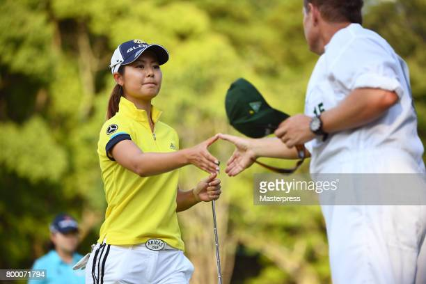 Ayaka Matsumori of Japan shake hands with her caddie after the second round of the Earth Mondamin Cup at the Camellia Hills Country Club on June 23...