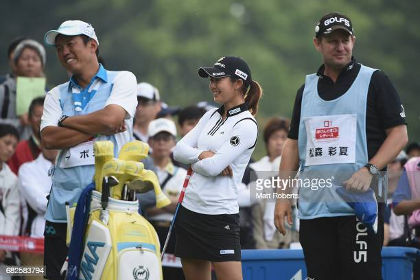Ayaka Matsumori of Japan shares a laugh before her tee shot on the 10th hole during the first round of the HokennoMadoguchi Ladies at the Fukuoka...