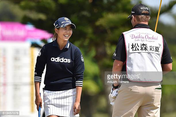 Ayaka Matsumori of Japan smiles during the first round of the Daikin Orchid Ladies Golf Tournament at the Ryukyu Golf Club on March 3 2016 in Nanjo...