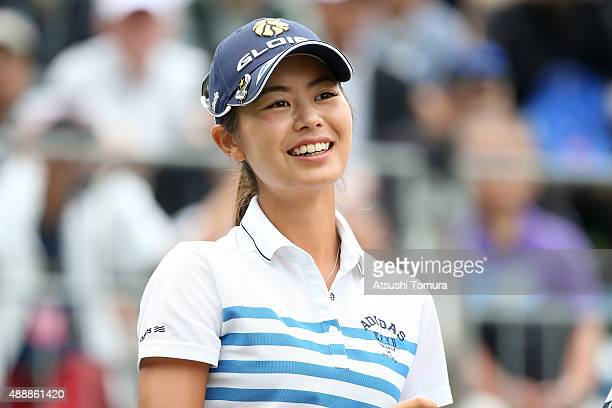 Ayaka Matsumori of Japan smiles during the first round of the Munsingwear Ladies Tokai Classic at the Shin Minami Aichi Country Club Mihama Course on...