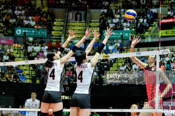 Ayaka Matsumoto and Risa Shinnabe of Japan jump and block the ball during the FIVB Volleyball World Grand Prix match between China and Japan on July...