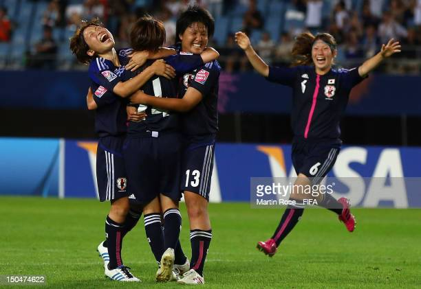 Ayaka Michigami of Japan celebrate with her team mate their opening goal during the FIFA U20 Women's World Cup 2012 group A match between Japan and...