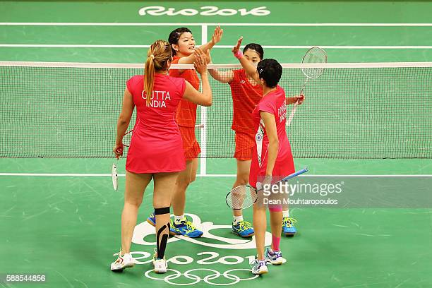 Ayaka Takahashi and Misaki Matsutomo of Japan high five each other after they compete against Ashwini Ponnappa and Jwala Gutta of India in the Womens...