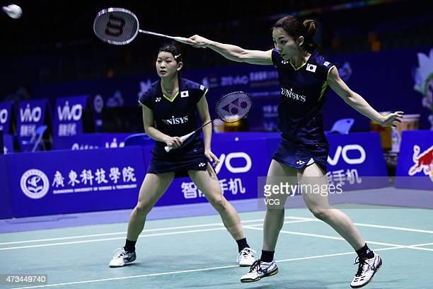 Ayaka Takahashi and Misaki Matsutomo of Japan return to Line Kjaersfeldt and Sara Thygesen of Denmark during Women's Doubles match on day six of 2015...