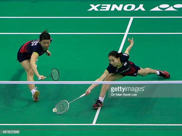 Ayaka Takahashi and Misaki Matsutomo of Japan returns a shot during the match between Misaki Matsutomo and Ayaka Takahashi of Japan and Tang Jinhua...