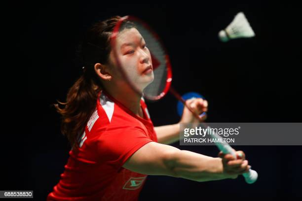 TOPSHOT Ayaka Takahashi of Japan hits a return during the women's doubles Sudirman Cup match with partner Misaki Matsutomo against Vivian Hoo and...