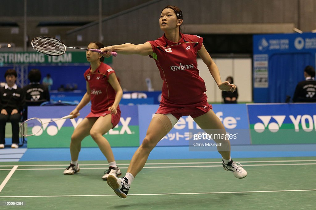 <a gi-track='captionPersonalityLinkClicked' href=/galleries/search?phrase=Ayaka+Takahashi&family=editorial&specificpeople=8671069 ng-click='$event.stopPropagation()'>Ayaka Takahashi</a> of Japan returns a shot as team mate <a gi-track='captionPersonalityLinkClicked' href=/galleries/search?phrase=Misaki+Matsutomo&family=editorial&specificpeople=6831788 ng-click='$event.stopPropagation()'>Misaki Matsutomo</a> watches on against Ye Na Jang and So Young Kim of Korea during their Women's Doubles semi final match on day five of the Badminton YONEX Open on June 14, 2014 in Tokyo, Japan.