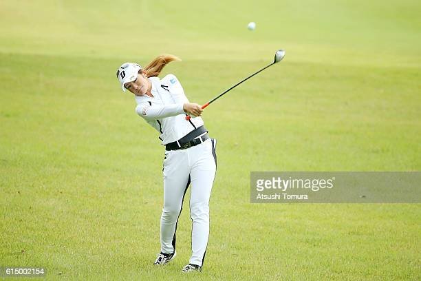 Ayaka Watanabe of Japan hits her second shot on the 1st hole during the final round of the Fujitsu Ladies 2016 at the Tokyu Seven Hundred Club on...