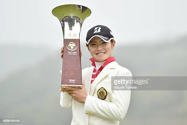 Ayaka Watanabe of Japan poses with the trophy after winning the YAMAHA Ladies Open Katsuragi at the Katsuragi Golf Club Yamana Course on April 5 2015...