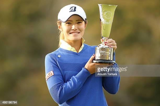 Ayaka Watanabe of Japan poses with the trophy after winning the Higuchi Hisako Ponta Ladies at the Musashigaoka Golf Course on November 1 2015 in...