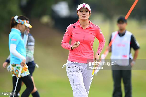 Ayaka Watanabe of Japan reacts after making her birdie putt on the 18th hole during the second round of the Fujitsu Ladies 2015 at the Tokyu Seven...