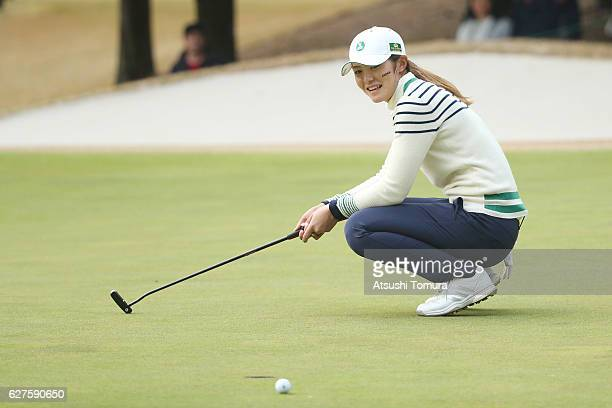 Ayaka Watanabe of Japan reacts after putting on the 17th green during the final round of the THE QUEENS Presented By KOWA at the Miyoshi Country Club...