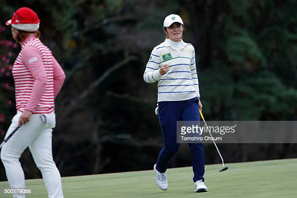 Ayaka Watanabe of the Ladies Professional Golf Association of Japan team right reacts after winning a match with YoonJi Cho of the Korea Ladies...