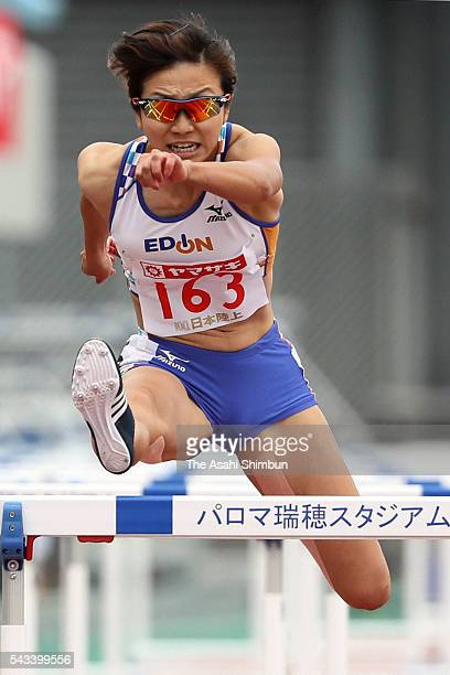 Ayako Kimura competes in the Women's 100m Hurdles during day three of the 100th Japan National Athletic Championships at the Paroma Mizuho Stadium on...