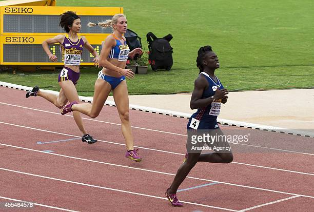 Ayako Kimura of Japan and Cindy Roleder of Germany are seen as Dawn Harper Nelson of USA running to the finish line during Womens 100m Hurdles Final...