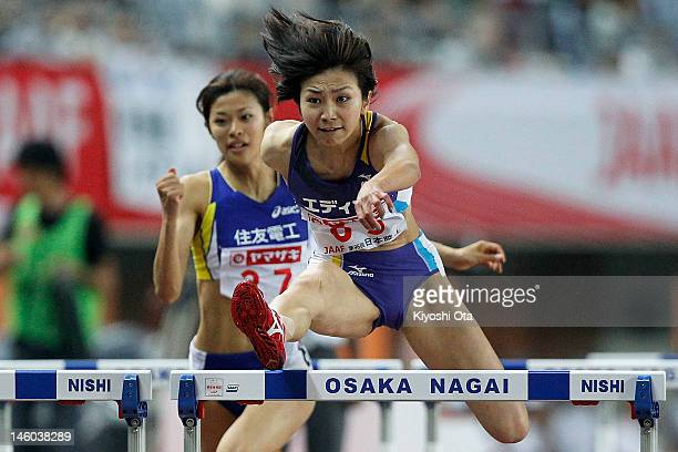 Ayako Kimura of Japan competes in the Women's 100m Hurdles final during day two of the 96th Japan National Championships at Nagai Stadium on June 9...