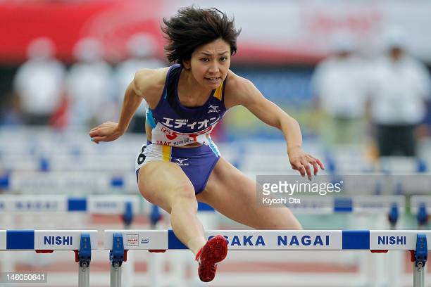 Ayako Kimura of Japan competes in the Women's 100m Hurdles semi final during day two of the 96th Japan National Championships at Nagai Stadium on...