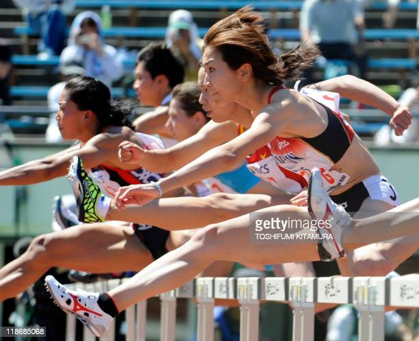 Ayako Kimura of Japan competes with Sun Yawei of China and other athletes during the women's 100metre hurdles heat 1 in the 2011 Asian Athletics...