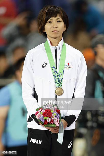 Ayako Kimura of Japan wins the bronze medal in Women's 100m Hurdles Final on day twelve of the 2014 Asian Games at Incheon Asiad Main Stadium on...