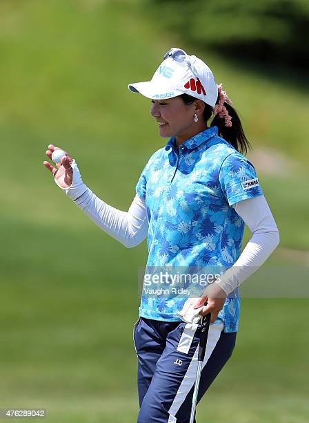 Ayako Uehara of Japan acknowledges the crowd after sinking a long putt on the 18th hole during the final round of the Manulife LPGA Classic at the...