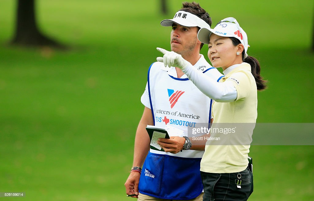 <a gi-track='captionPersonalityLinkClicked' href=/galleries/search?phrase=Ayako+Uehara+-+Golf&family=editorial&specificpeople=4690711 ng-click='$event.stopPropagation()'>Ayako Uehara</a> of Japan and her caddie line up a shot on the second hole during the second round of the Volunteers of America Texas Shootout at Las Colinas Country Club on April 29, 2016 in Irving, Texas.