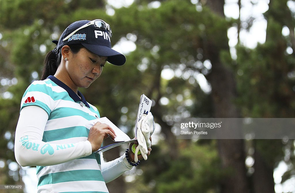 Ayako Uehara of Japan checks her notes during day two of the ISPS Handa Australian Open at Royal Canberra Golf Club on February 15, 2013 in Canberra, Australia.