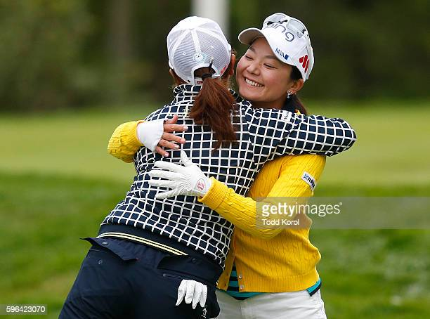 Ayako Uehara of Japan gets a hug from Mika Miyazato of Japan after getting a hole in one on the 11th hole during the third round of the Canadian...