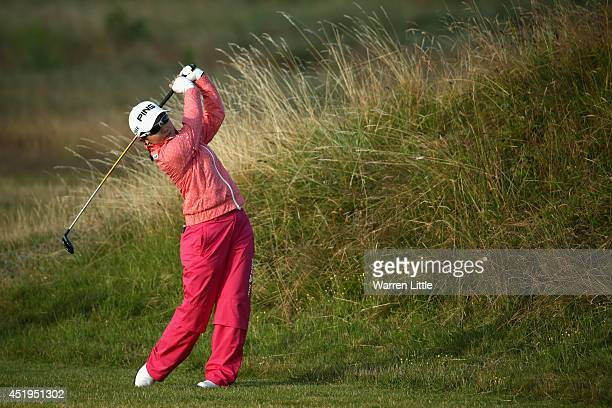 Ayako Uehara of Japan hits her 2nd shot on the 1st hole during the first round of the Ricoh Women's British Open at Royal Birkdale on July 10 2014 in...