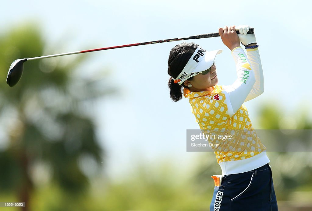 Ayako Uehara of Japan hits her tee shot on the d16th hole during the first round of the Kraft Nabisco Championship at Mission Hills Country Club on April 4, 2013 in Rancho Mirage, California.