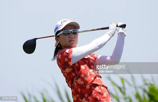 Ayako Uehara of Japan hits her tee shot on the third hole during the final round of the ShopRite LPGA Classic presented by Acer on the Bay Course at...