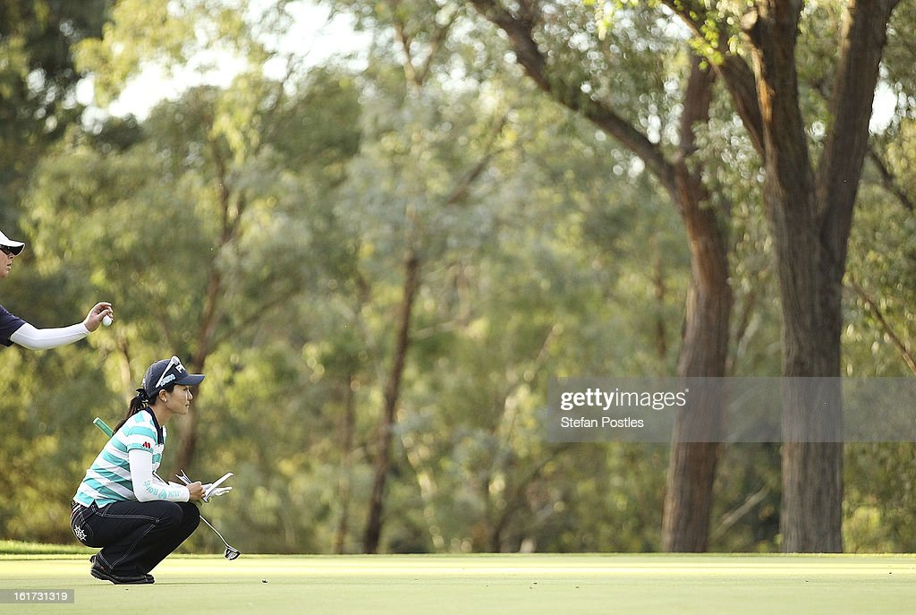 Ayako Uehara of Japan lines up a putt during day two of the ISPS Handa Australian Open at Royal Canberra Golf Club on February 15, 2013 in Canberra, Australia.